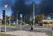 Black smoke from shelling rises near the International airport in Donetsk