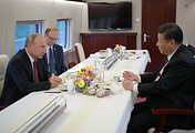 Russia's President Vladimir Putin and China's President Xi Jinping in a train on their way to the city of Tianjin