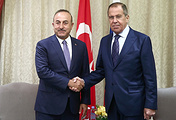 Turkey's Minister of Foreign Affairs Mevlut Cavusoglu (L) and Russia's Minister of Foreign Affairs Sergei Lavrov