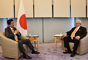 Prime Minister of Japan Shinzo Abe and First Deputy Director General of TASS Mikhail Gusman
