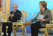 Russia's president Vladimir Putin and German chancellor Angela Merkel at the 12th St Petersburg Dialogue Forum in Moscow in 2012