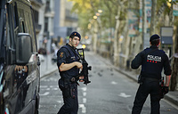 Armed police officers patrol a street in Las Ramblas, Barcelona