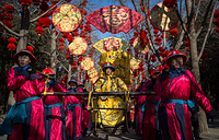 Chinese performers dressed in traditional costumes perform during a rehearsal of a reenactment of a Qing dynasty (1636-1912) imperial sacrifice ritual to worship the Earth, on the eve of the Chinese Lunar New Year, at Ditan Park in Beijing, China