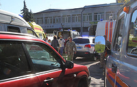 Ambulance and police vehicles at the site of a bomb blast at a college in the Crimean city of Kerch