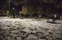 Cars are locked in a road covered with hail in Rome
