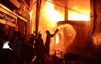 A devastating fire raced through at least five buildings in an old part of Bangladesh's capital and killed scores of people