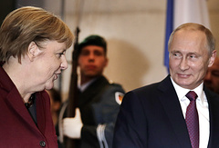 German Chancellor Angela Merkel welcomes the President of Russia Vladimir Putin for a summit with the leaders of Russia, Ukraine and France