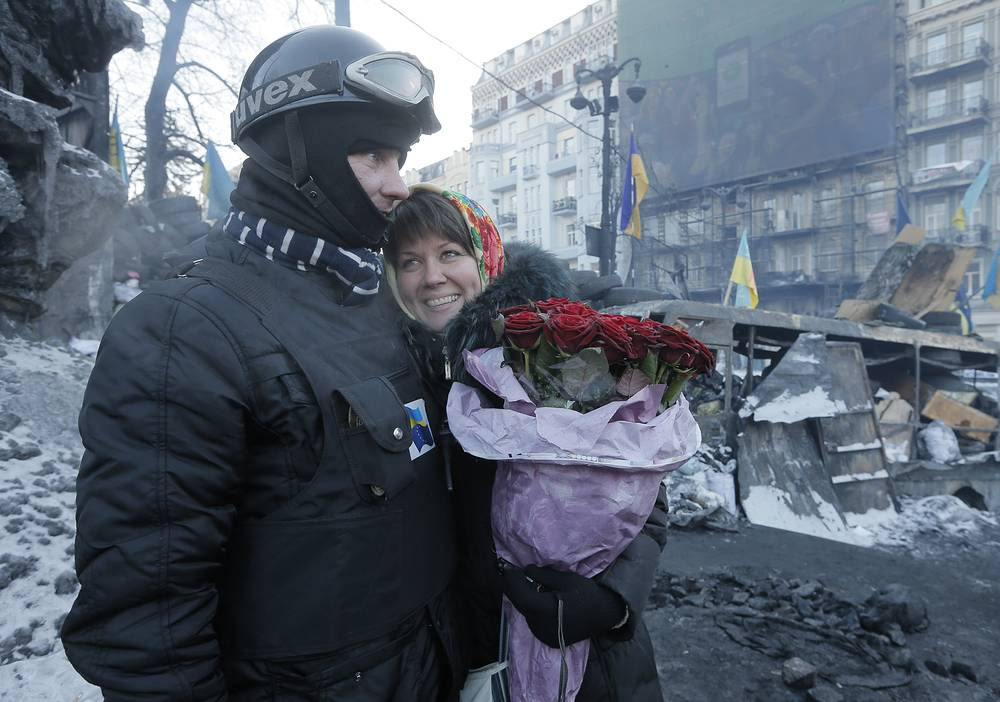 Protesters have long got used to the life on edge. This image shows an opposition supporter and his future bride after he asked her to marry him at barricades in central Kiev