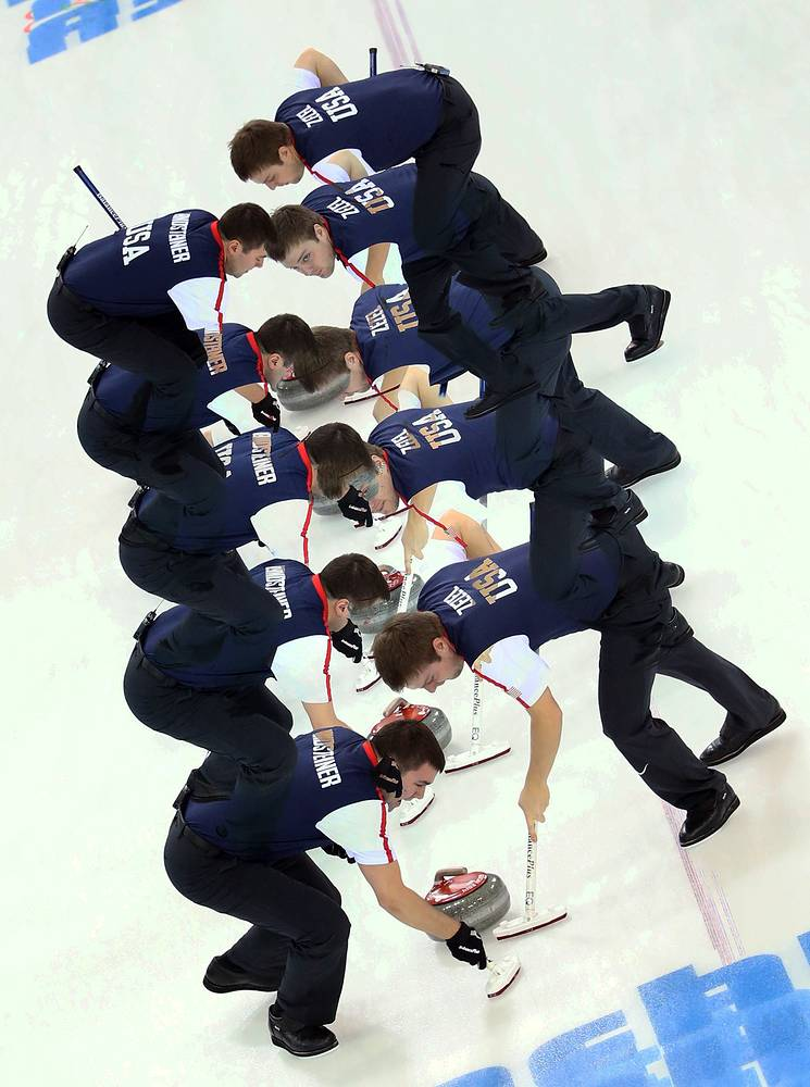US team sweep during the Round Robin curling match between China and USA