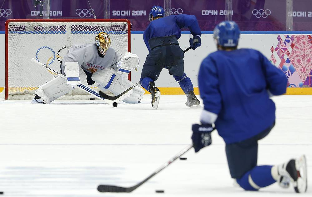 Finland goaltender Tuukka Rask defends against defenseman Olli Maatta during a training session