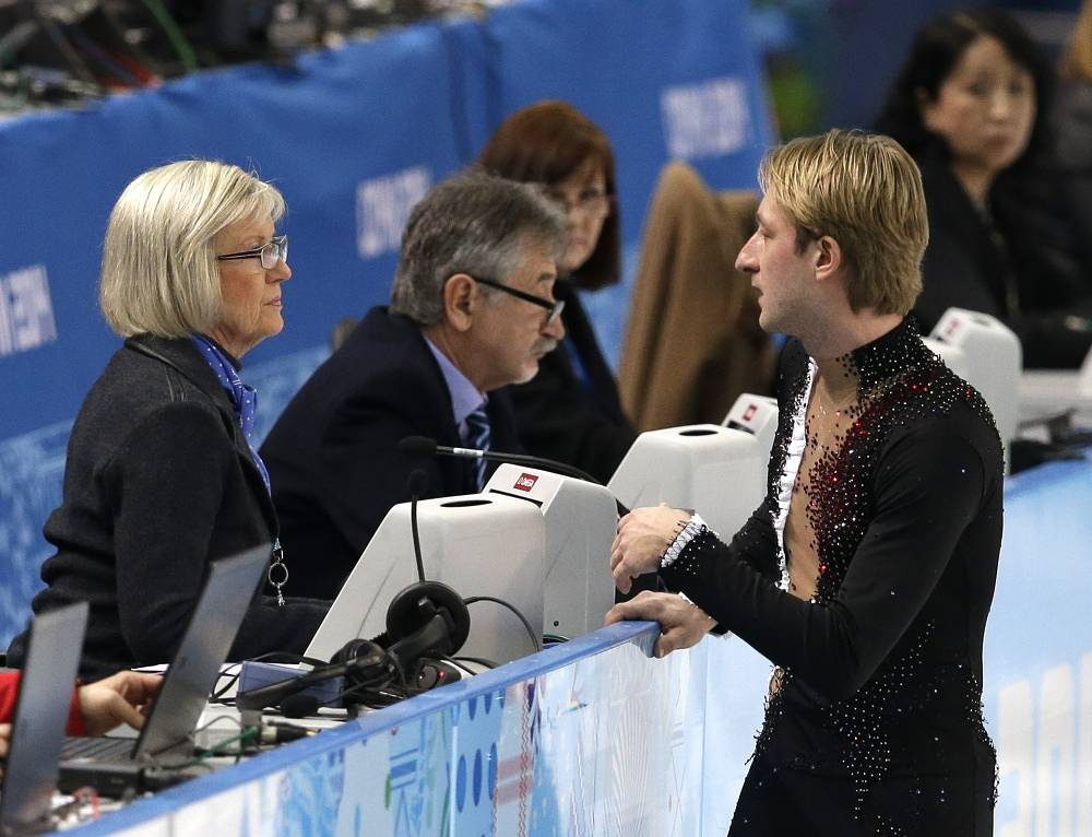 While warming up, Plushenko jumped, landed badly and injured his back, which was the reason for not performing