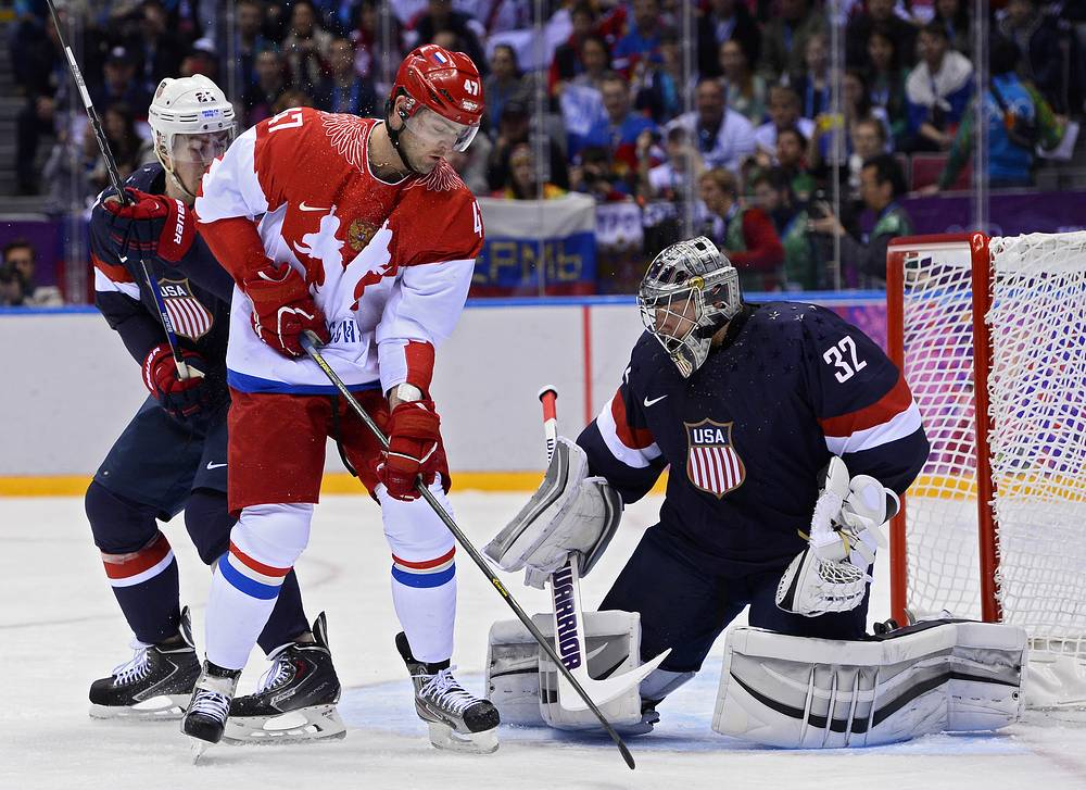 Goalkeeper Jonathan Quick (R) of the USA and Alexander Radulov (C) of Russia