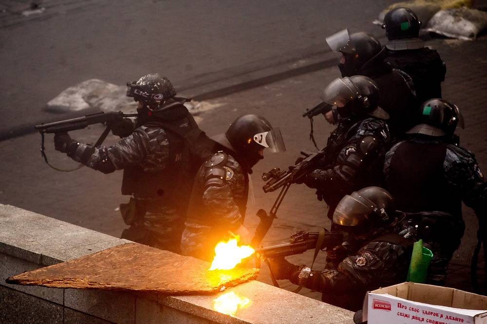 Riot police fire at anti government demonstrators
