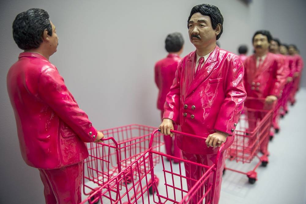 "Composition ""15 pieces of Pink Man: Icon of Consumerism"" by Thai artist Manit Sriwanichpoom"