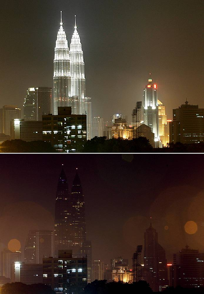 Malaysia's landmark, the Petronas Twin Towers along with other buildings before and after the lights were switched off