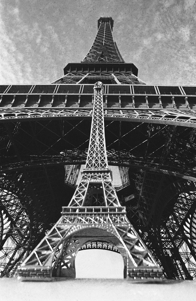 Every year over 57 tonns of paint is used to keep the tower from rusting. Photo: Eiffel Tower seen in the background of a smaller copy.