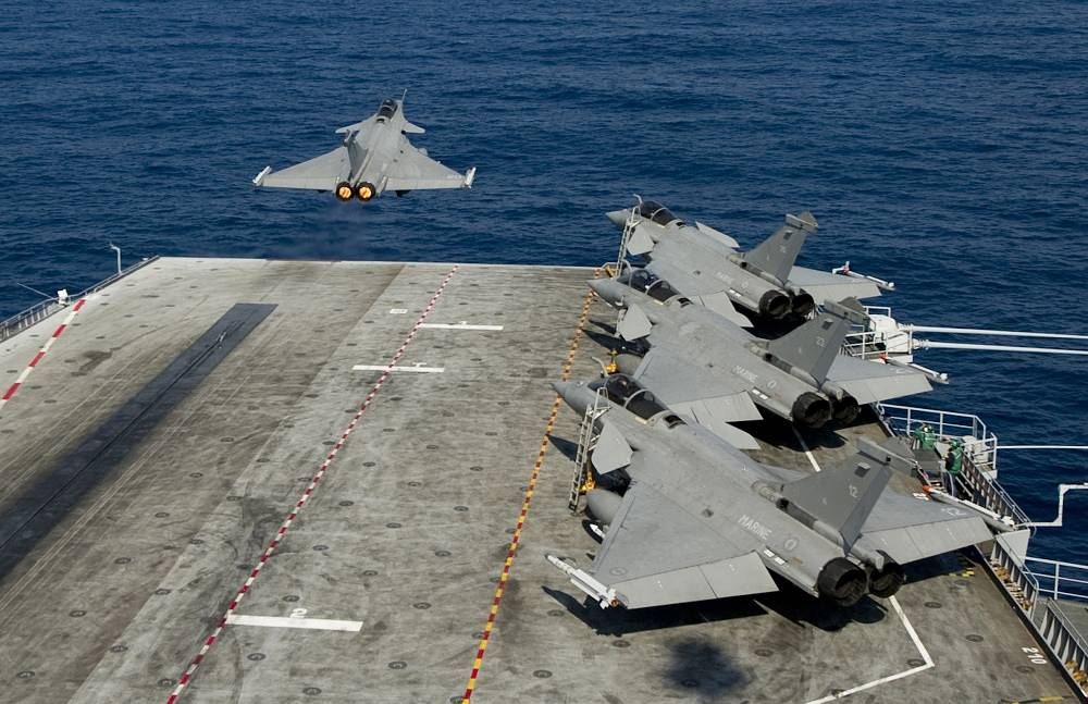 In 2011 NATO conducts operation 'Unified Protector' in Lybia. Photo: a NATO fighter jet taking off from the French aircraft carrier Charles de Gaulle
