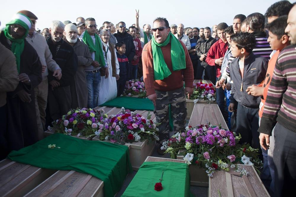 In 2011 NATO conducts operation 'Unified Protector' in Lybia. Photo: mass funeral of the NATO airstrikes victims