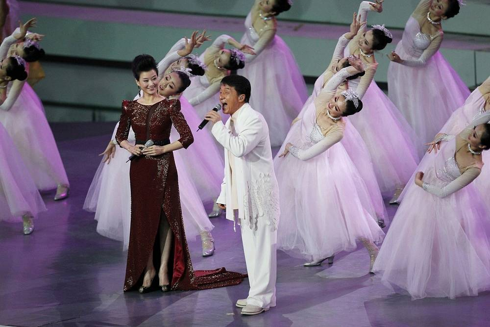 The actor is also known as a pop-singer. He has over 100 songs  and 20 albums. Photo: Jackie Chan and Chinese singer Song Zhuying