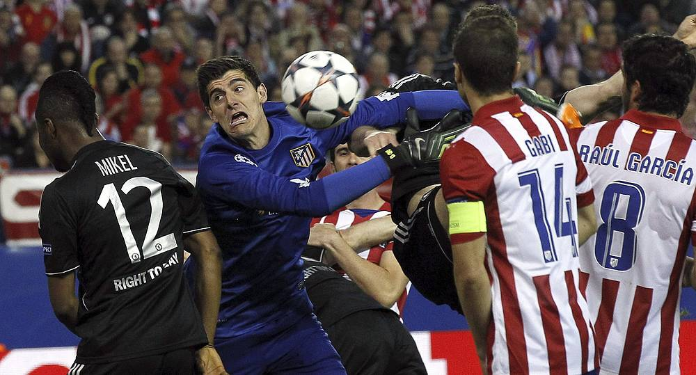 Atletico Madrid's Belgian goolkeeper Thibaut Courtois tries to catch the ball