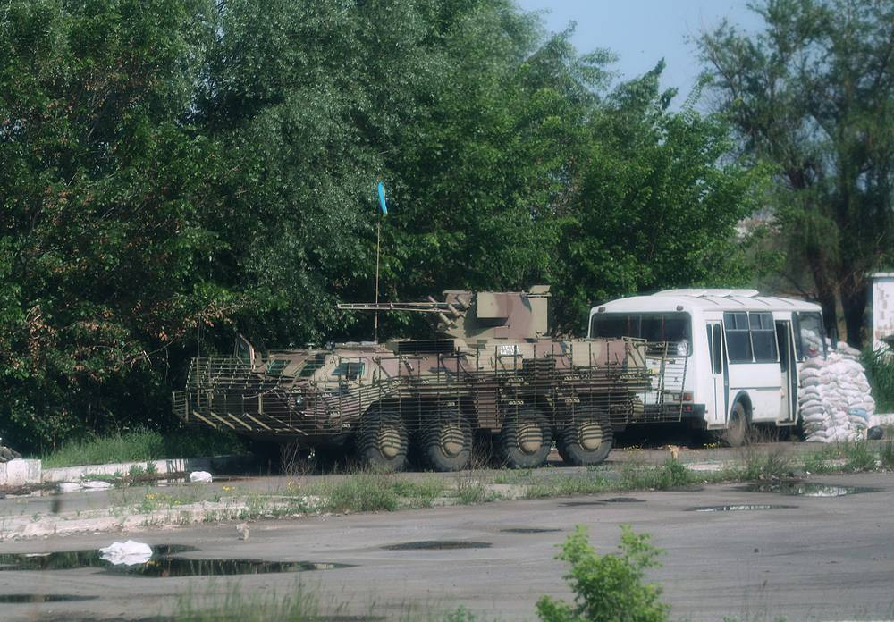 An armored vehicle at a Ukrainian armed forces' checkpoint on Kharkiv-Rostov highway