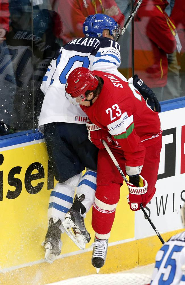 Jere Karalahti (L) of Finland in action against Belarus player Andrei Stas