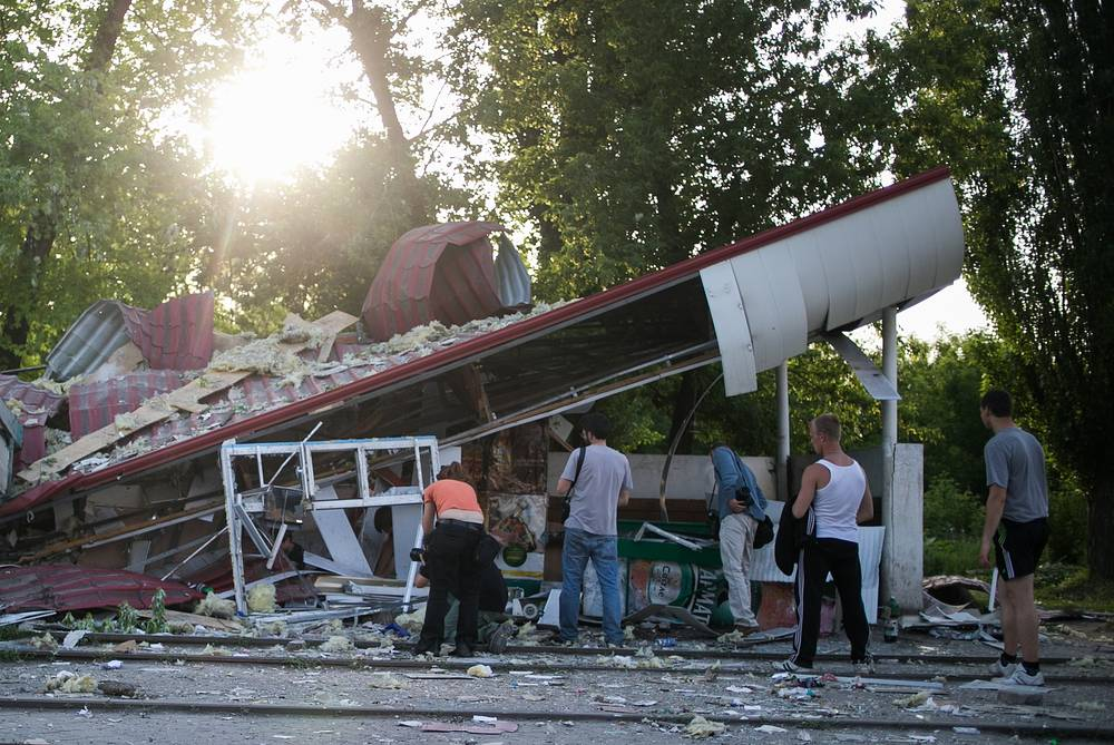Kramatorsk residents at a shop destroyed during a Ukrainian forces shelling attack