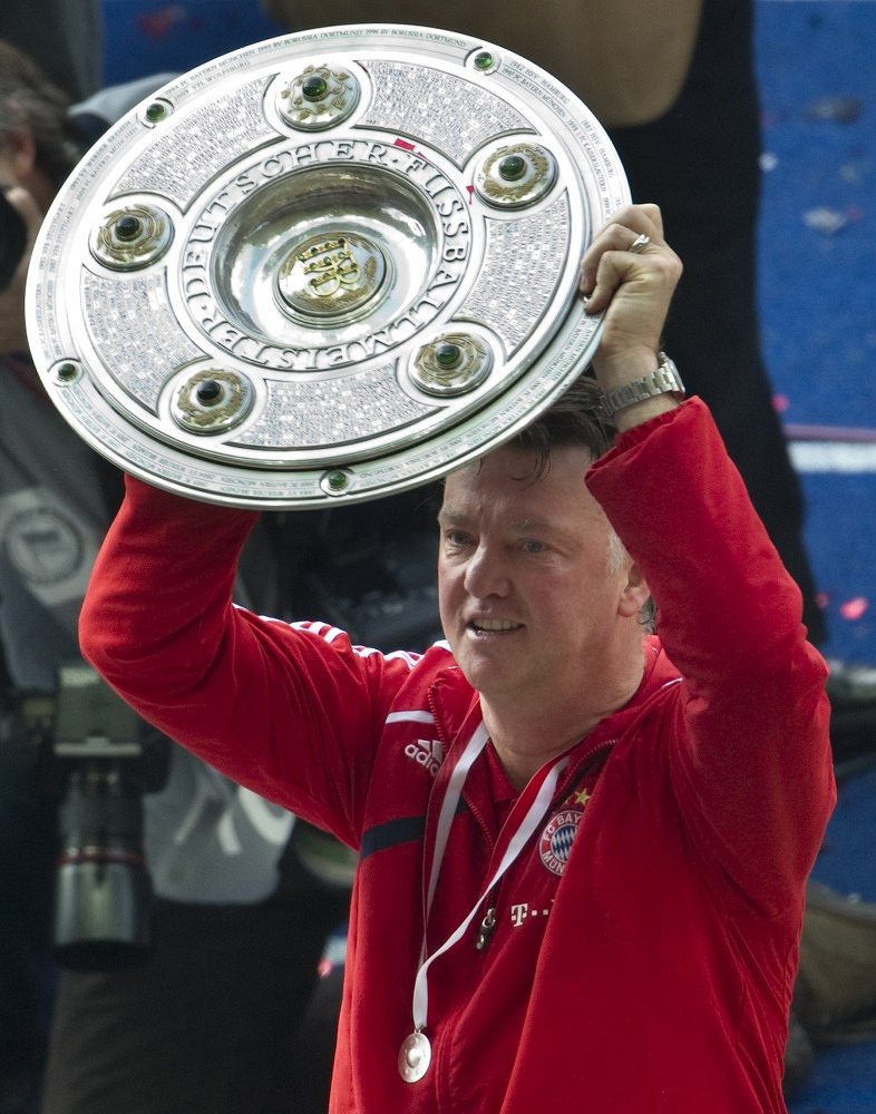 Louis van Gaal celebrates with the trophy after becoming the new Bundesliga champion with Bayern Munich