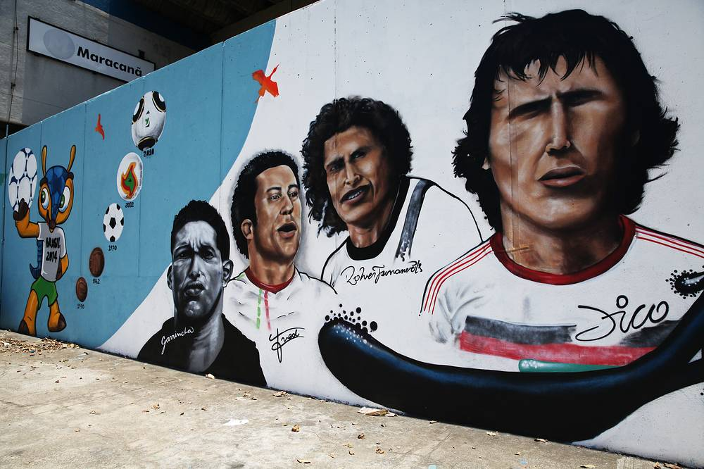 A mural at the Maracana train station shows Brazilian soccer players (L-R) Garrincha, Fred, Carlos Roberto de Oliveira (nicknamed Roberto Dinamite) and Zico, joined on the far left by FIFA World Cup 2014 mascot Fuleco