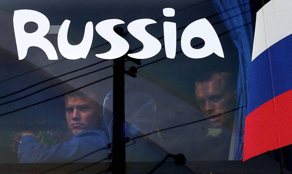 Russian national team members seen in a window of their bus