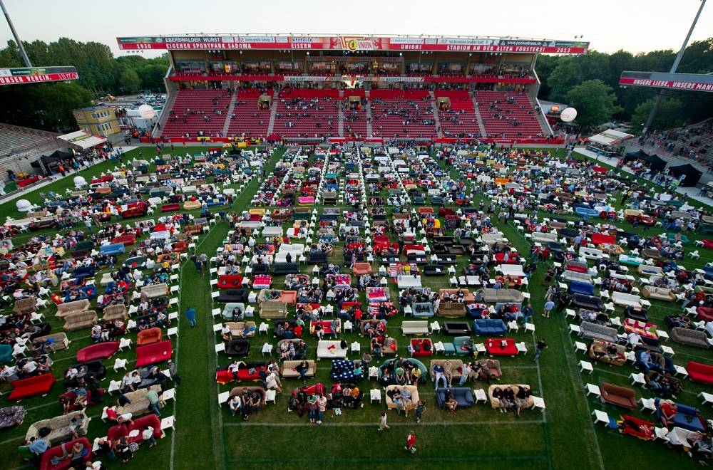 Supporters from Berlin watched the opening match of the World Cup sitting on sofas at the Alte Foersterei Arena stadium