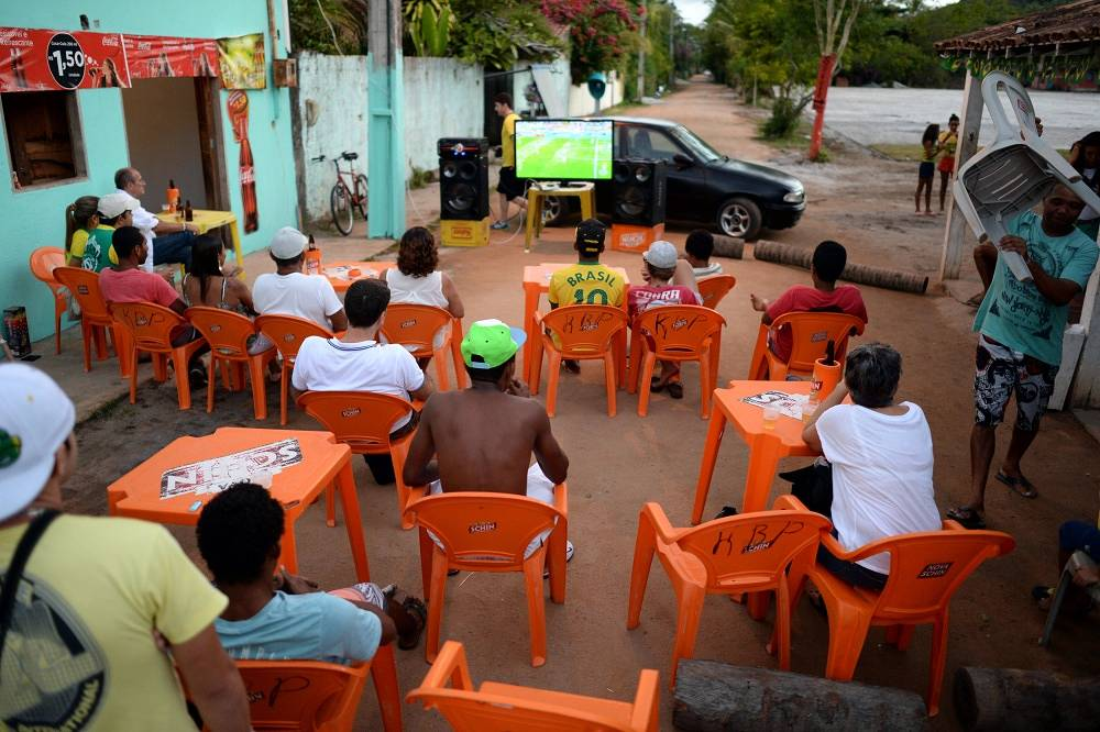 Viewers watching football near a bar in Santo Andre, Brazil