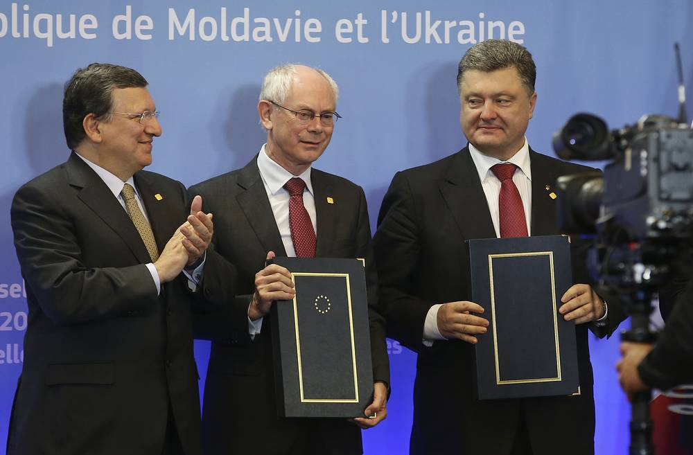 European Commission President Jose Manuel Barroso, European Council President Herman Van Rompuy and Ukrainian President Petro Poroshenko