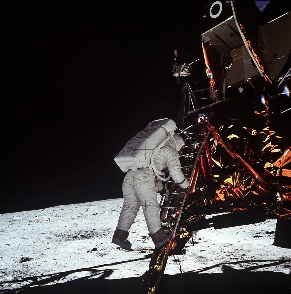 US astronaut Edwin E. Aldrin, Jr., descends the steps of the Lunar Module as he prepares to walk on the moon