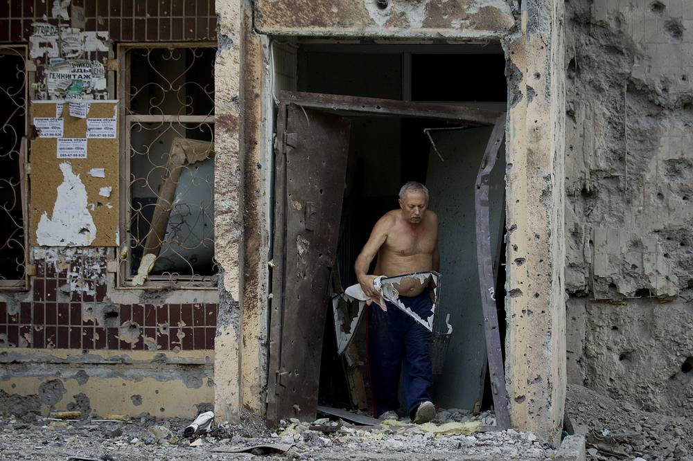 Damaged houses after a shell hit a residential area in Donetsk