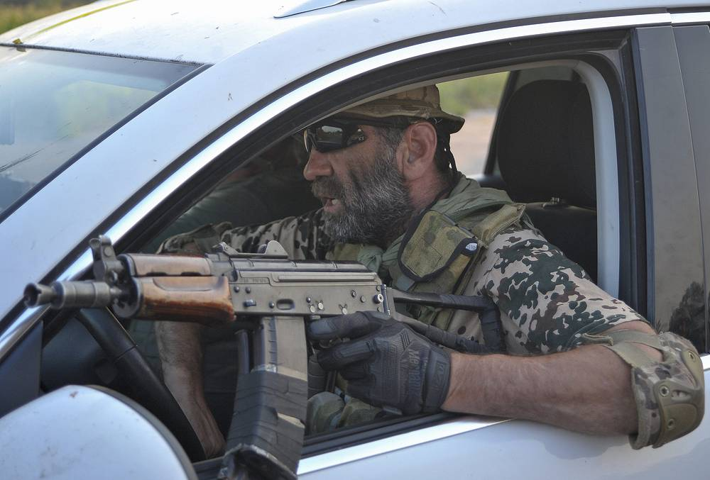 A soldier of Ukrainian battalion 'Donbas' drives a car in Luhansk Region