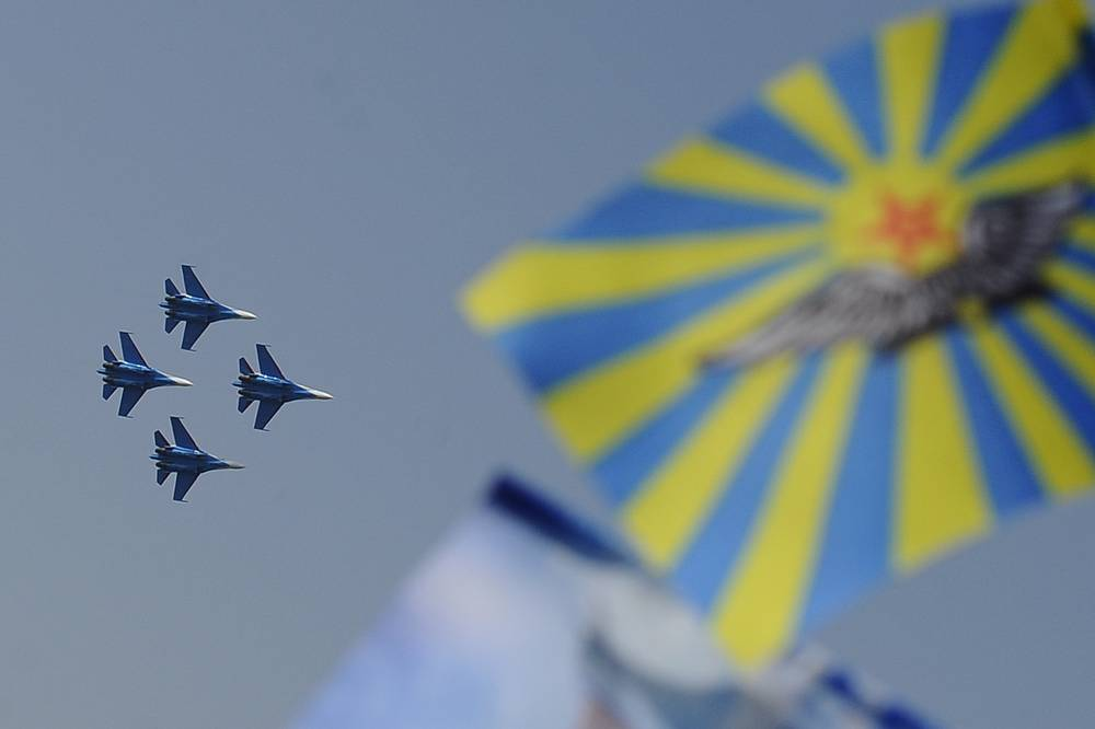 The Russkiye Vityazi (Russian Knights) aerobatic team performs during the Russian Air Force Day celebration