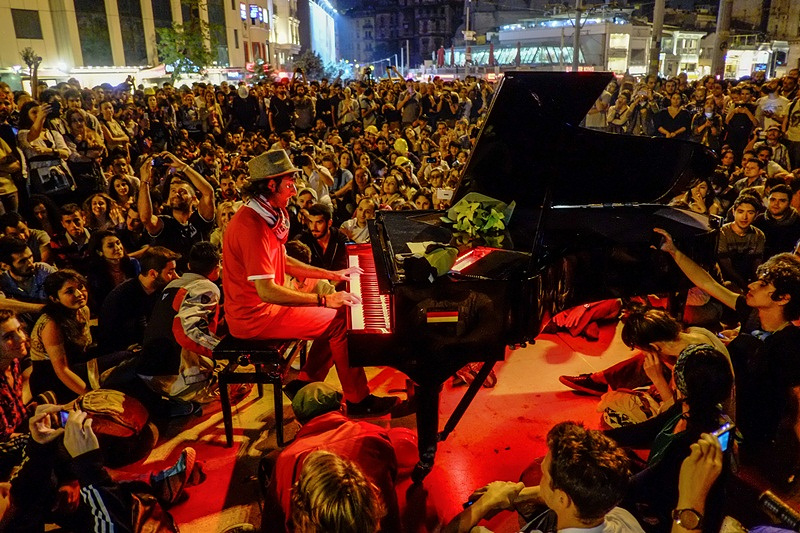 A man plays the piano for the protesters in Istanbul's Taksim Square, 2013