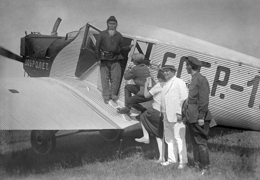 Delegates of the All-Union Congress of Soviets are heading to the congress on a Dobrolyot company's plane, 1929