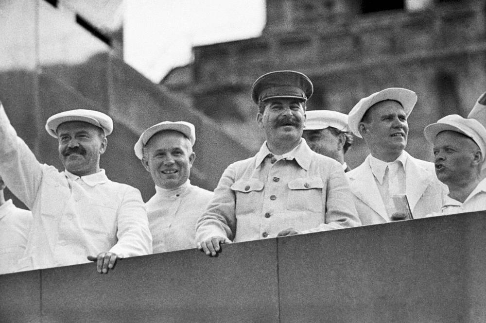 A gymnasts' parade on Red Square, 1936. On the Lenin's Mausoleum tribune (L-R): V. Molotov, N. Khrushchev, Iosif Stalin and other officials