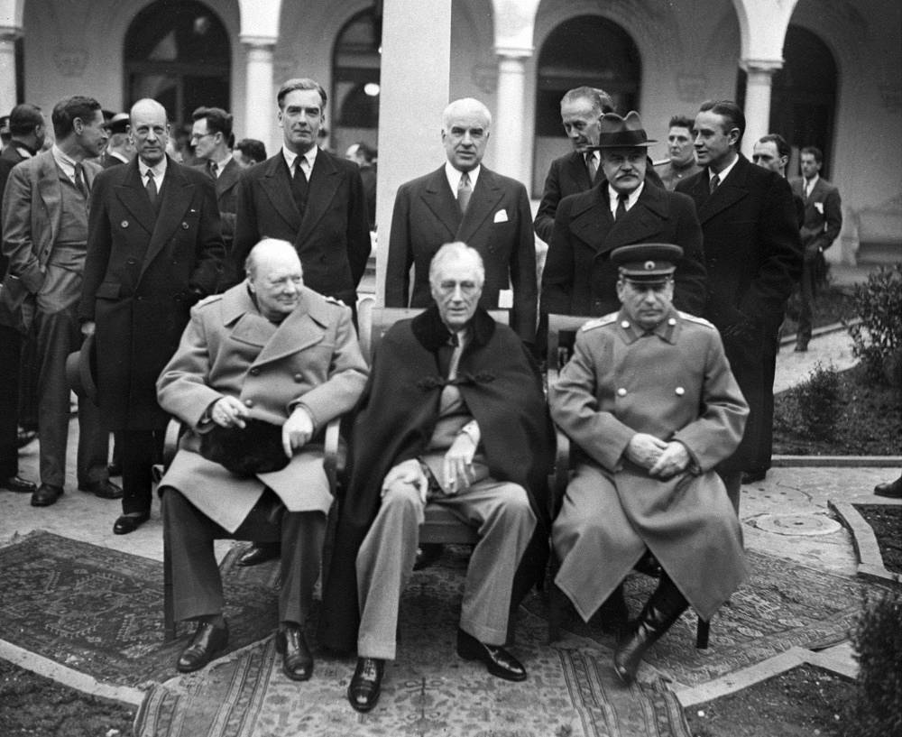 The Yalta Conference on February 11, 1945. British Prime Minister Winston Churchill, US President Franklin D. Roosevelt and General of the USSR Iosif Stalin before one of the sessions. Standing: British Foreign Secretary Anthony Eden, US Secretary of State Edward Stettinius and Public Commisioner for Foreign Affairs of the USSR Vyacheslav Molotov