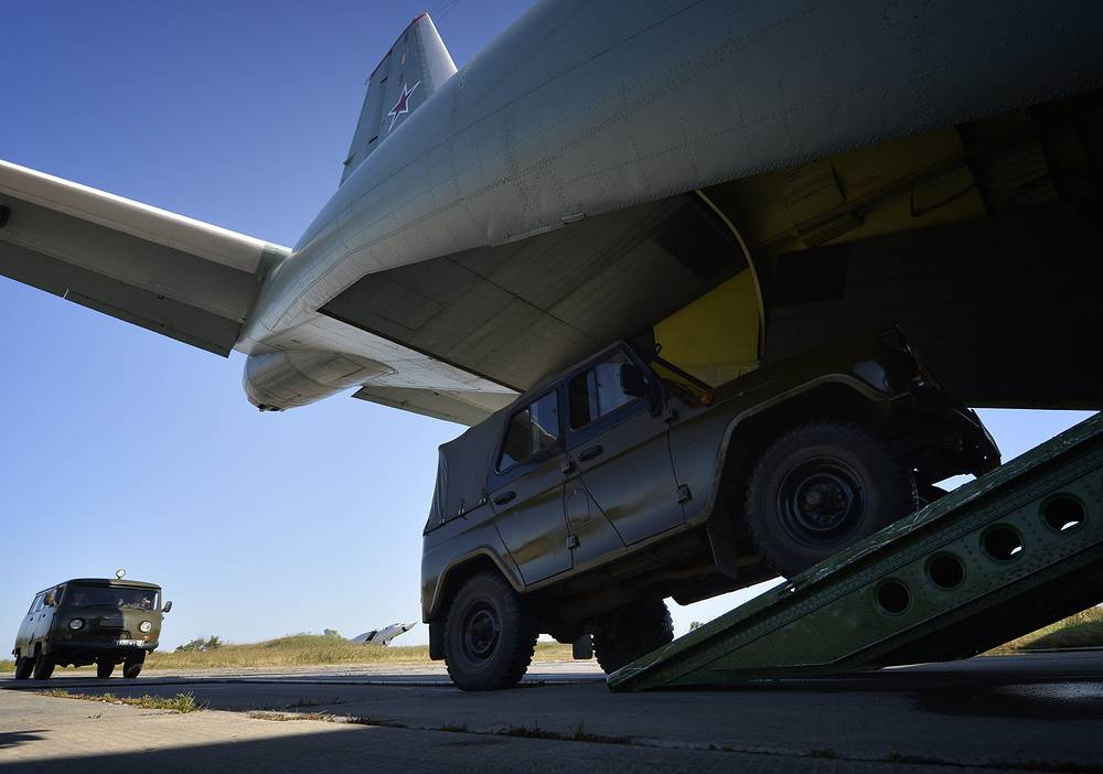 Military hardware being loaded onto an Antonov An-12 cargo aircraft