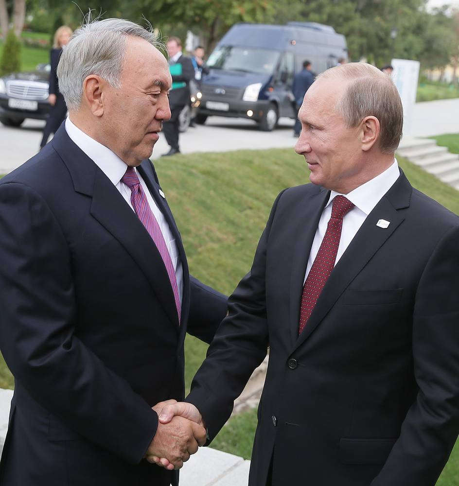 Vladimir Putin greets his Kazakh counterpart Nursultan Nazarbayev