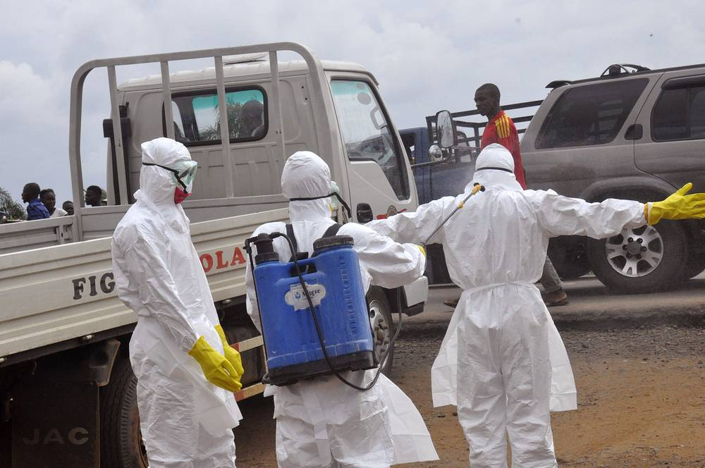 West Africa's largest Ebola treatment center was opened in the capital of Liberia. Photo: Health worker's spray each other with disinfectant chemicals in Monrovia, Liberia, September 4, 2014