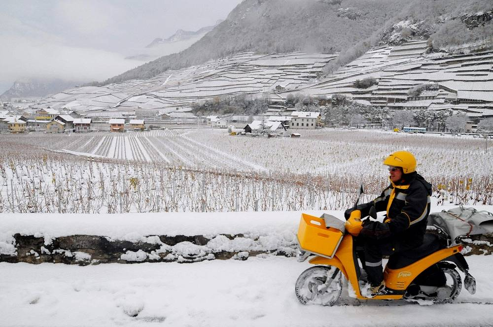 Mail delivery on a motorcycle in Switzerland
