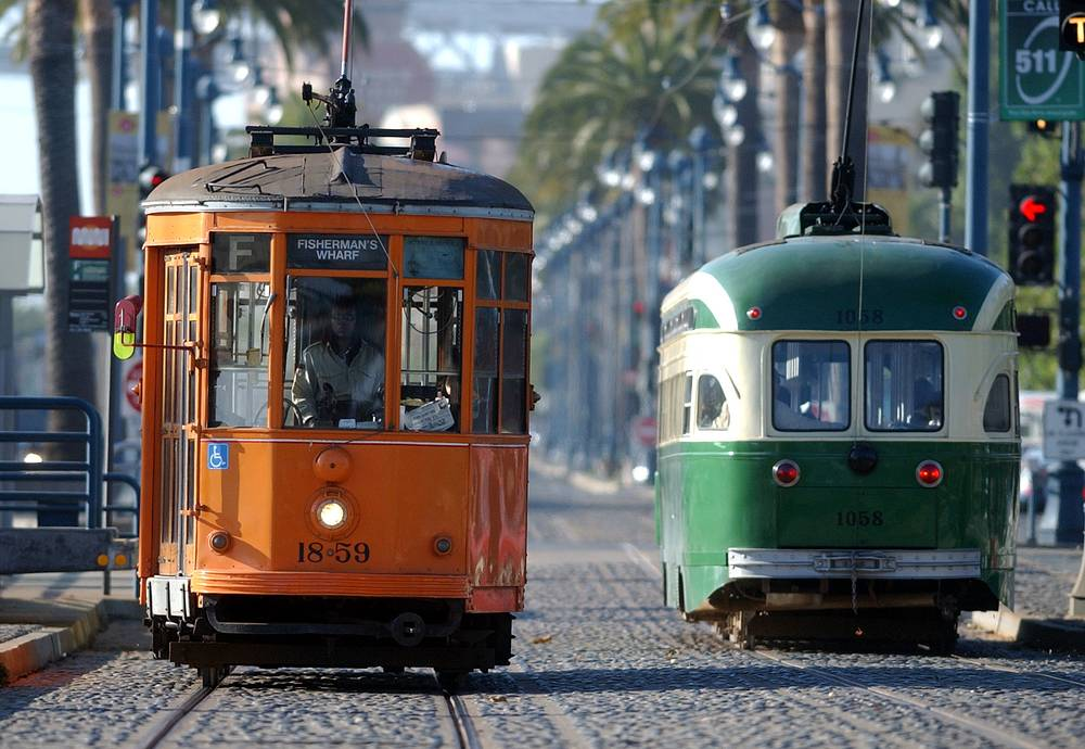 One of the most diverse collections of vintage streetcars can be seen in San Francisco. Photo: Two streetcars pass each other on Market Street in San Francisco, USA