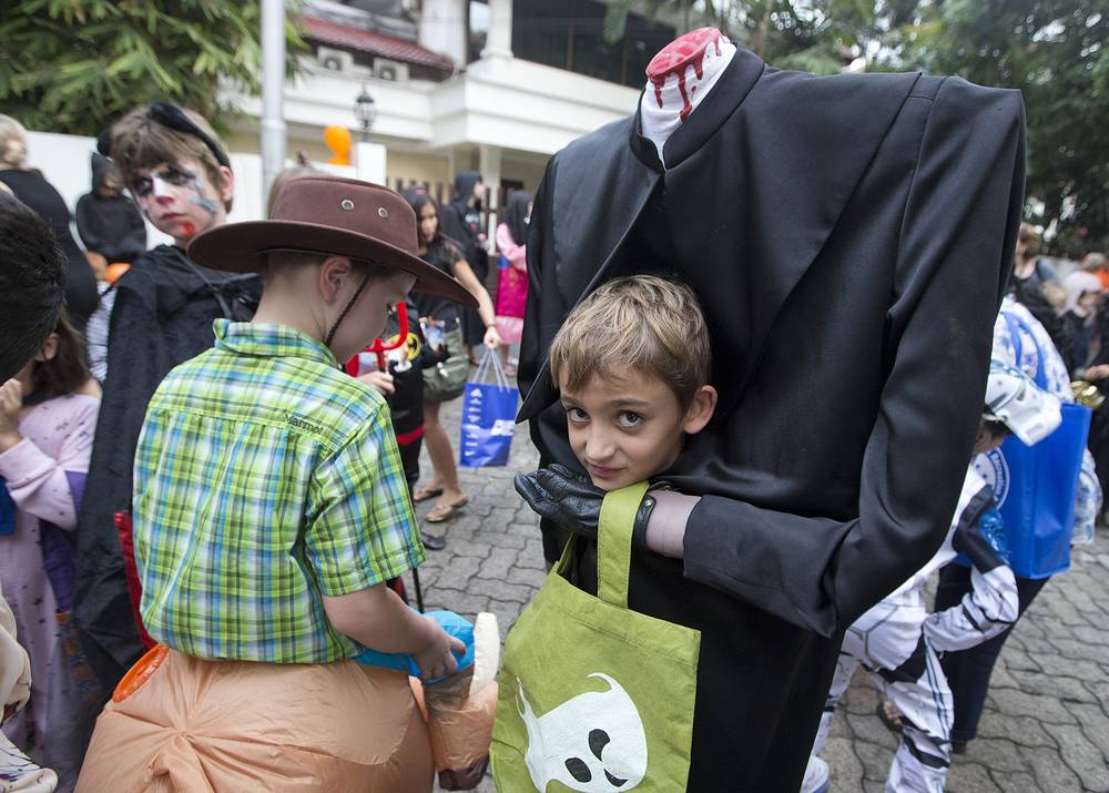 "Halloween's ""Trick or Treat"" is the most popular tradition among the children in the urban areas as they travel from house to house for free candies and sweets. Photo: A group of children dressed for Halloween in Jakarta, Indonesia, October 31, 2014"