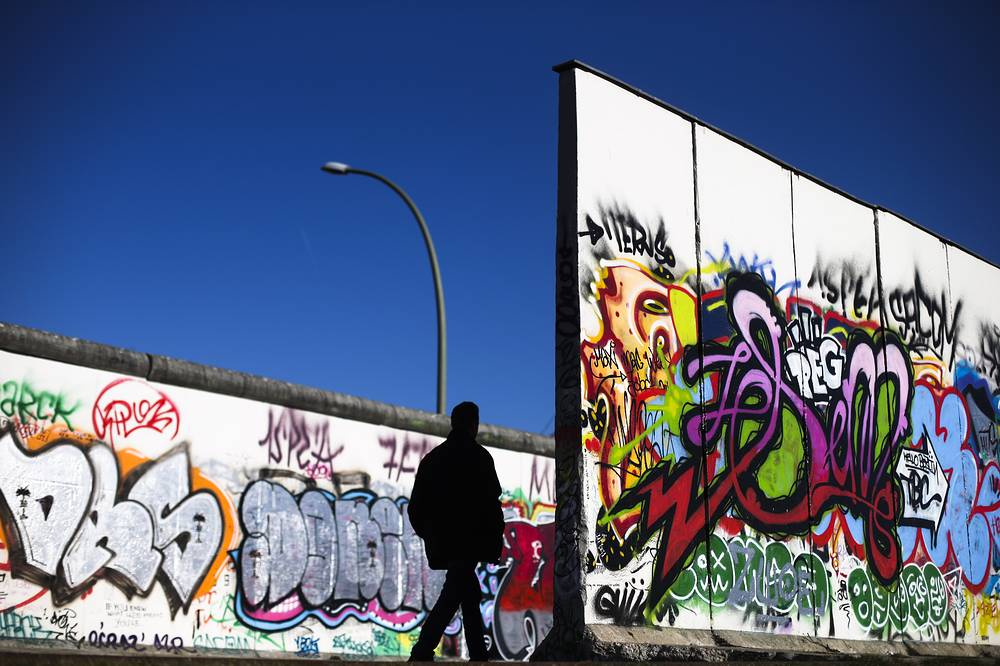 The 1300 meters long East Side gallery, a part of the Wall which separated East Berlin from the river Spree where the border was located in that area, is the longest original part of the Berlin Wall