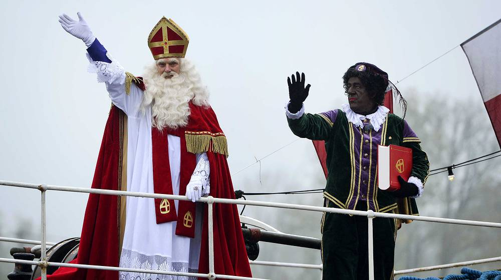 Sinterklaas from Netherlands is a traditional figure based on Saint Nicholas. Photo: Sinterklaas and a his companion Zwarte Piet in Gouda, The Netherlands, where Saint Nicolas festival is celebrated on the evening of 05 December