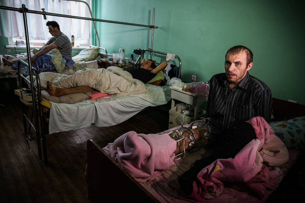 Photo: Men at a hospital after they were injured as a result of shelling in Donetsk region